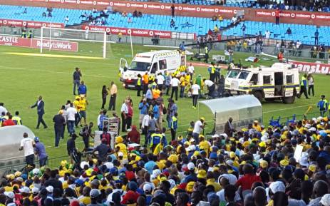Police try to disperse angry Orlando Pirates fans who stormed the Loftus Versveld field during their teams clash with Mamelodi Sundowns. Picture: Twitter/@EWNsport.
