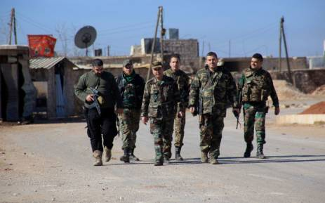 Syrian government forces walk in the village of Tal Jabin, north of the embattled city of Aleppo, on 3 February 2016. Picture: George Ourfalian / AFP.