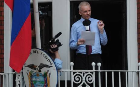 Wikileaks founder Julian Assange addresses the press and his supporters from the balcony of the Ecuadorian Embassy in London. Picture: AFP.