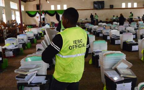 FILE: Kenya's Independent Electoral and Boundaries Commission officials make a sweep of electoral material 7 August 2017 at a holding centre in Kagio before their distribution to the polling stations a day before Kenya goes to the general election. Picture: AFP.