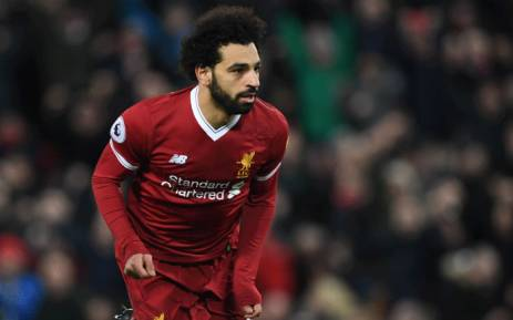 Liverpool's Egyptian midfielder Mohamed Salah celebrates scoring the team's first goal during the English Premier League football match between Liverpool and Leicester at Anfield in Liverpool, north west England on 30 December 2017. Picture: AFP.