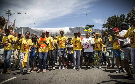 FILE: ANC members dance and sing down Buitenkant Street in Cape Town after holding an anti-racism march outside of the DA headquarters: Thomas Holder/EWN.