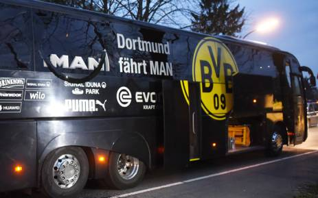 Borussia Dortmund's damaged bus is pictured after an explosion some 10km away from the stadium prior to the Uefa Champions League 1st leg quarterfinal football match against Monaco. Picture: AFP.
