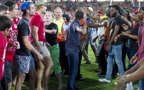Students and protesters clash during a rugby match at the University of the Free State on 22 February 2016. Picture: EPA.