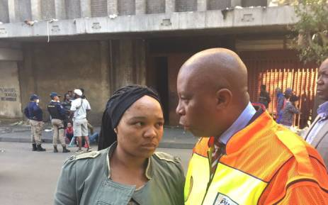 Johannesburg mayor Herman Mashaba with the mother of the 13-year-old girl who was kidnapped and believed inside the hijacked building. Picture: Twitter @HermanMashaba.
