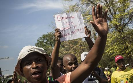 A student holds up a placard during demonstrations at the University of the Free State main campus in Bloemfontein on 23 February 2016. PIcture: Reinart Toerien/EWN.