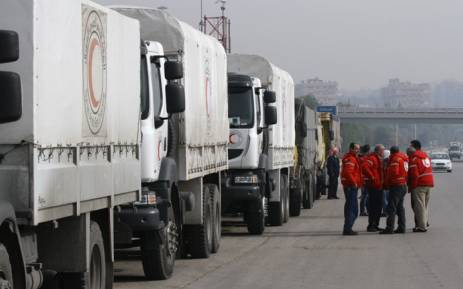 Syrian Red Crescent aid convoys carrying food, medicine and blankets, leave the capital Damascus as they head to the besieged town of Madaya on January 11, 2015.Picture: AFP.