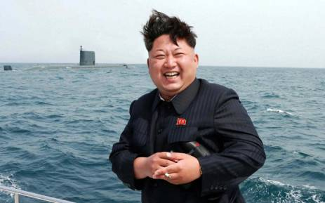 This undated picture released from North Korea's official Korean Central News Agency (KCNA) on 9 May 2015 shows North Korean leader Kim Jong-Un smiling while observing an underwater test-fire of a submarine-launched ballistic missile at an undisclosed location at sea. Picture: AFP.