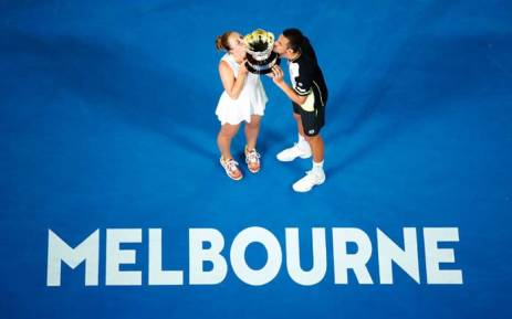 Australian Open mixed doubles winners Mate Pavic and Gabriela Dabrowski kiss the trophy. Picture: @WTA/Twitter.