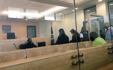 A Verulam man, seated on the right, appeared in court on charges of rape and sexually grooming his 10-year-old stepdaughter. Picture: Ziyanda Ngcobo/EWN.