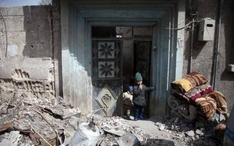 FILE: Syrians flee their homes with their belongings in the town of Beit Sawa in Syria's besieged eastern Ghouta region on 4 March 2018, following reported air strikes. Picture: AFP.