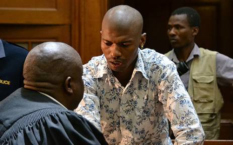 Xolile Mngeni consults with his lawyer on 19 November 2012 in the Western Cape High Court right after hearing that he had been found guilty of the murder of Anni Dewani. Picture: Aletta Gardner/EWN