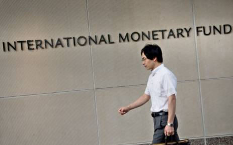 FILE: A man walks past the headquarters of the International Monetary Fund (IMF) in Washington, DC. Picture: AFP.