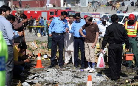 FILE: Pakistani security officials inspect the site of a bomb explosion at a fruit and vegetable market in Islamabad on 9 April 2014. Picture: AFP.