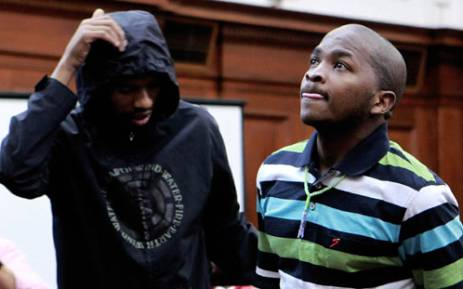 Xolile Mngeni (L) and Mziwamadoda Qwabe (R), accused in the murder of honeymooner Anni Dewani, appear in the Western Cape High Court in Cape Town on Friday, 10 February 2012. Picture: Nardus Engelbrecht/SAPA