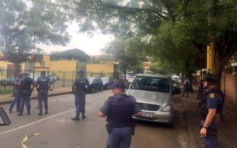 Police monitor the situation in Kempton Park as a tense standoff between the police and residents ensued after a man was killed. Picture: Emily Corke/EWN.