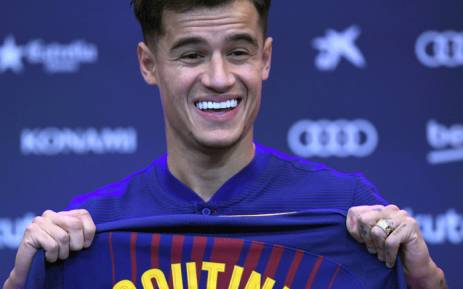 FILE: Barcelona's new Brazilian midfielder Philippe Coutinho shows his new jersey before holding a press conference in Barcelona on 8 January 2018. Picture: AFP.