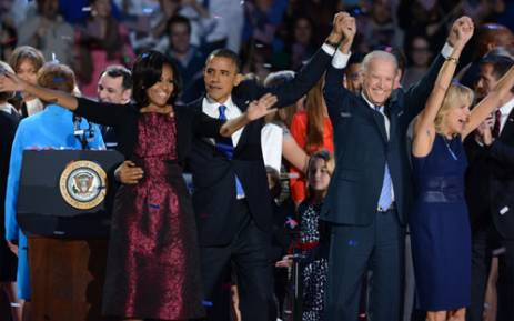 US First Lady Michelle Obama, US President Barack Obama, US Vice President Joe Biden and his wife Jill Biden celebrate on election night November 7, 2012 in Chicago, Illinois. Obama and Biden won re-election to a second 4-year term. Picture: AFP.