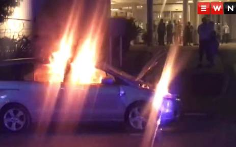 FILE: A screengrab shows a car torched during clashes between Uber and meter taxi drivers on 7 September 2017. Picture: EWN