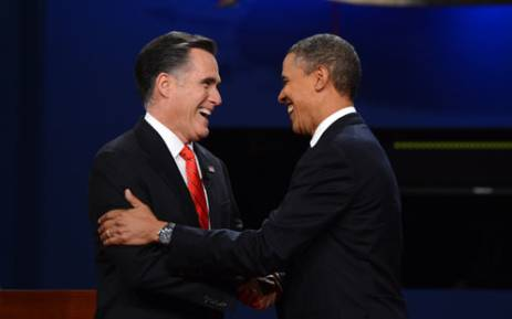US President Barak Obama and Republican opponent Mitt Romney shake hands after the first presidential debate in Denver Colorado. Picture: AFP.""