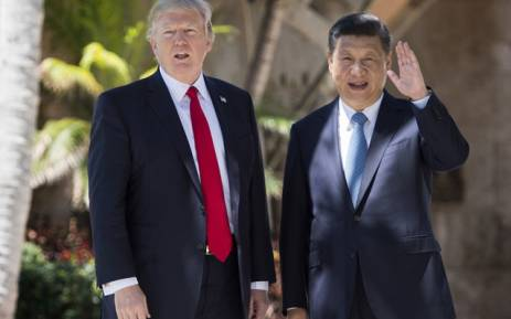 Chinese President Xi Jinping (R) waves to the press as he walks with US President Donald Trump at the Mar-a-Lago estate in West Palm Beach, Florida, April 7, 2017. Picture: AFP.