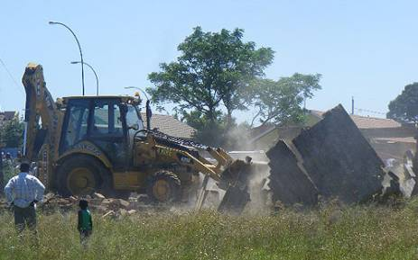 The Gauteng housing department demolished 30 half-built structures in Lenasia's Extension 4 on 19 November 2012. Picture: Theo Nkonki/EWN