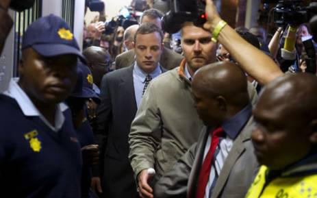 Oscar Pistorius leaves the Pretoria Magistrates court on June 4 after appearing for killing his girlfriend Reeva Steenkamp. Picture: AFP.