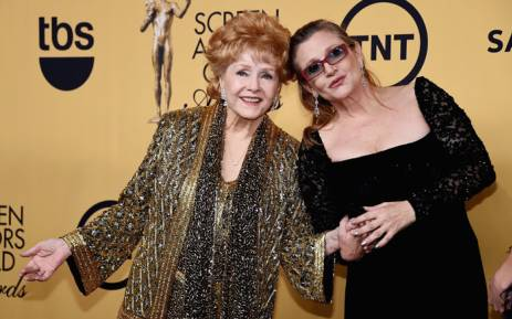 FILE: This photo taken on 24 January 2015 shows actresses Debbie Reynolds (L) and her daughter Carrie Fisher. Picture: AFP.