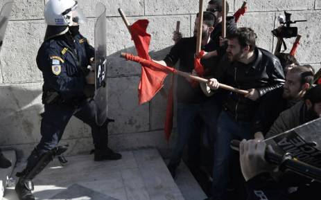 Greece erupts: Chaos in Athens as demonstrators clash with police