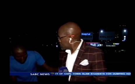 Screengrab of a YouTube video showing SABC's contributing editor, Vuyo Mvoko, being mugged during a live crossing on 10 March 2015.