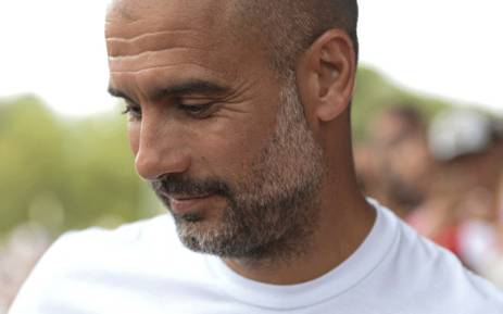 Manchester City's Spanish coach Pep Guardiola looks downwards before the annual 41st Costa Brava Trophy friendly football match between Girona FC vs Manchester City at the Montilivi stadium in Girona on 15 August 2017. Picture: AFP.