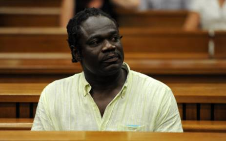 Former Nigerian Olympic athlete Ambrose Monye, during his appearance with co-accused Andre Gouws in connection with the murder of Chanelle Henning. Picture: Werner Beukes/SAPA.