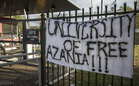 FILE: Protesting students at the University of the Free State placed a banner on a gate close to the entrance of the institution's main campus on 25 February 2016. Picture: Reinart Toerien/EWN.