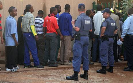 Some of the arrested Lonmin mineworkers preparing to appear in the Ga-Rankuwa Magistrate's Court on 3 September, 2012. Picture: Taurai Maduna.