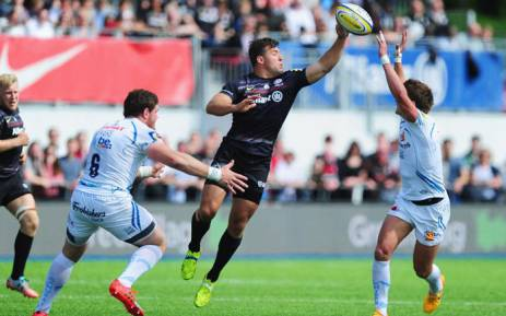 FILE: Schalk Brits of Saracens offloads the ball under pressure from Dave Ewers (6) and Henry Slade of Exeter Chiefs (R) during the Aviva Premiership match between Saracens and Exeter Chiefs at Allianz Park on 10 May 2015 Picture: Rugbyworldcup.com