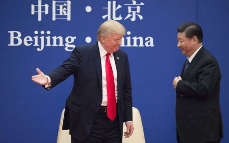 US President Donald Trump (L) gestures next to China's President Xi Jinping during a business leaders event at the Great Hall of the People in Beijing on 9 November 2017. Picture: AFP