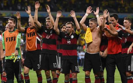 Germany's players celebrate their team's victory at the end of the semi-final football match between Brazil and Germany at The Mineirao Stadium in Belo Horizonte during the 2014 Fifa World Cup on 8 July 2014. Picture: AFP.