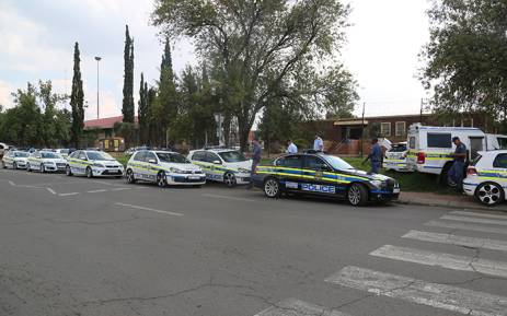 Police gathered at the Katlehong police station following looting of multiple busineses. Picture: Kgothatso Mogale/EWN.