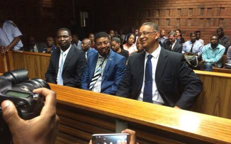 From left to right: Former Independent Police Investigative Directorate (Ipid) investigators Matthews Sesoko and Innocent Khuba & head Robert McBride in court on Wednesday 16 March 2016. Picture: Barry Bateman/EWN.