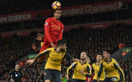 Liverpool's German-born Cameroonian defender Joel Matip jumps to win a header during the English Premier League football match between Liverpool and Arsenal at Anfield in Liverpool, north west England on 4 March 2017. Liverpool won the game 3-1. Picture: AFP.