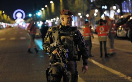 A French soldier patrols on the Champs Elysees in Paris after a shooting on 20 April 2017. One police officer was killed and another wounded today in a shooting on Paris's Champs Elysees police said just days ahead of France's presidential election. P