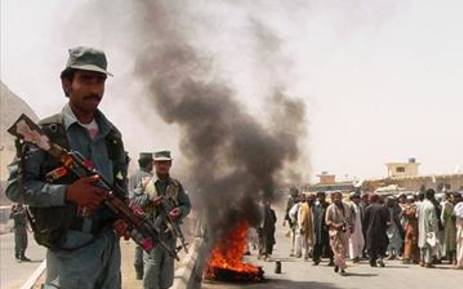 Afghanistan police stand guard as people protest. Picture: AFP