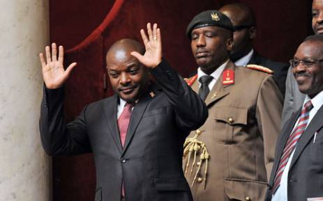 Burundi President Pierre Nkurunziza waves as he attends a weekly session of questions to the government on March 12, 2013 at the National Assembly in Paris. AFP PHOTO / PIERRE ANDRIEU.