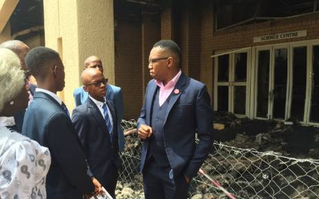 Deputy Minister of Higher Education Mduduzi Manana has inspected the fire damage at North West University and has condemned the destruction of the institution's facilities. Picture: Vumani Mkhize/EWN.