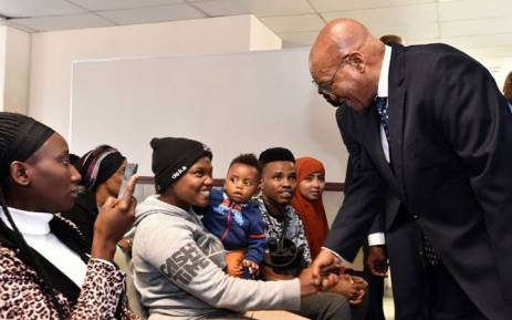 President Jacob Zuma greets refugees during his tour of the Desmond Tutu Refugee Reception Centre. Picture: GCIS