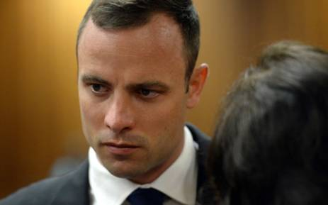 Oscar Pistorius before the start of proceedings on 24 March 2014 at the High Court in Pretoria. Picture: Pool.