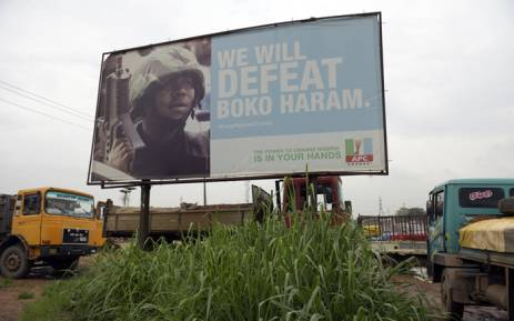 FILE: A photo shows a campaign signboad displayed by the ruling All Progressives Congress (APC) to show its readiness to defeat Boko Haram Islamists on assumption office at Ogijo, Ogun State in southwest Nigeria. Picture: AFP.