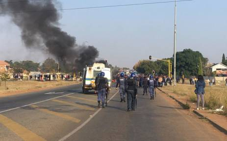 South African police fire rubber bullets as protest turns to riot