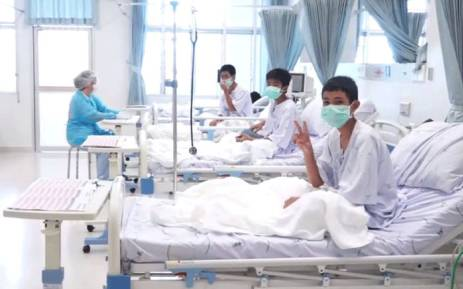 This handout video grab taken from footage released by The Thai government public relations department and government spokesman bureau on 11 July 2018 shows members of the Wild Boars football team being treated at a hospital in Chiang Rai. Picture: AFP