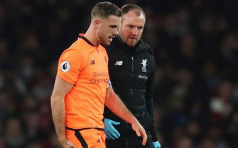 Liverpool midfielder Jordan Henderson (left) is helped off the field after picking up an injury. Picture: @LFC/Twitter